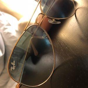 Light blue shade Ray Ban Sunglasses.